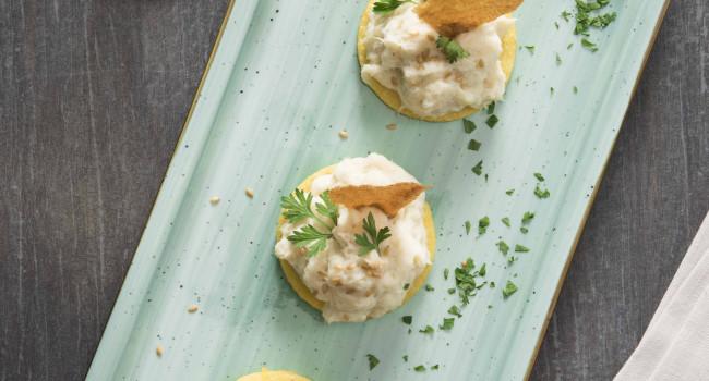 Creamed salted cod on crispy polenta