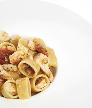 CALAMARATA PASTA WITH SEAFOOD SAUCE AND DATTERINI TOMATOES