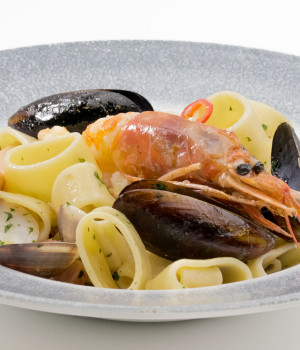 Calamarata pasta with withe wine seafood sauce