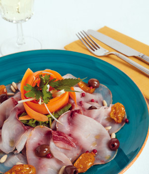 Swordfish carpaccio with yellow datterini tomatoes and olives