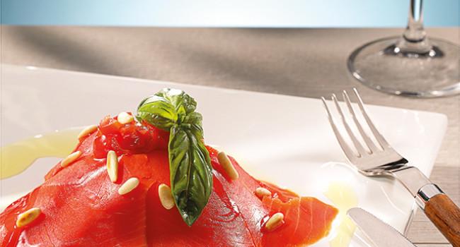 Salmon carpaccio with fennel,datterini tomatoes and pinenuts