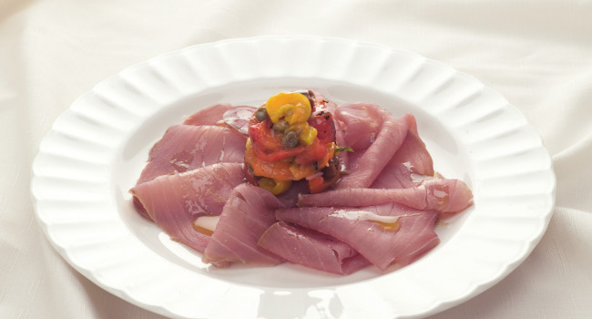 Smoked tuna carpaccio with roasted peppers, capers and  basil olives