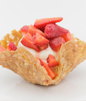 Basket with Chantilly cream and strawberries