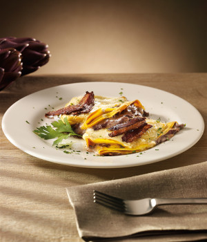 Crêpes with radicchio, fondue and crispy goose breast