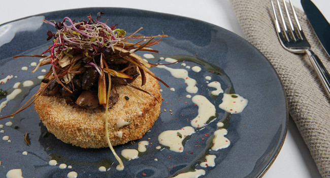 Crispy rice cake with truffle mushrooms and fried leeks