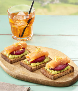 MULTIGRAIN CROSTINI WITH GUACAMOLE, SWEET AND SOUR RED ONION AND SMOKED SALMON