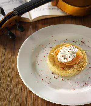 Crostini with burrata cheese and smoked salmon