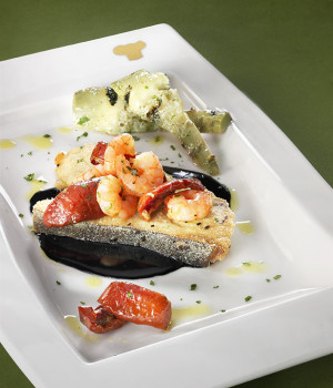 Pieces of swordfish with squid ink, shrimps, Soleggiati Sun Blushed Tomatoes and grilled artichokes