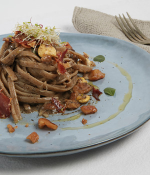 Cocoa Fettuccine with truffle, lupini beans and acacia honey chestnuts