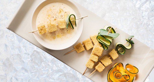 Finger food of polenta with parmigiano and porcini soup