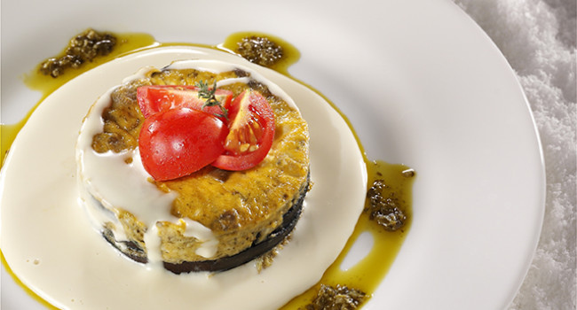 Eggplant flan with basil pesto and parmigiano cheese sauce