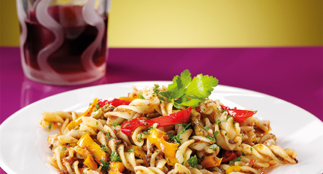 Fusilli pasta with three colours peppers