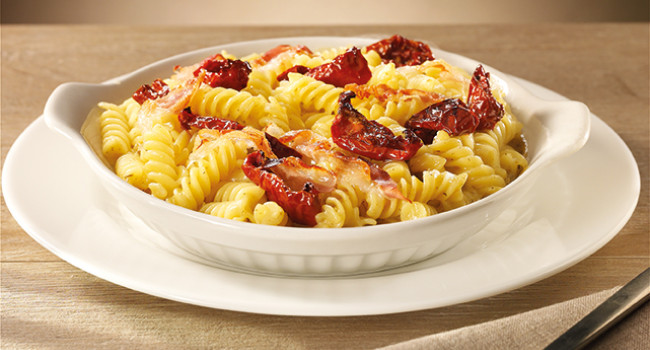 Fusilli pasta with smoked scamorza, guanciale and sage