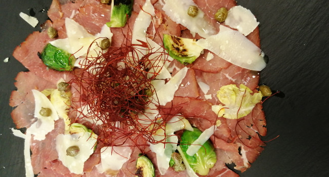 Smoked beef carpaccio, brussel sprouts, small capers and shaved parmigiano