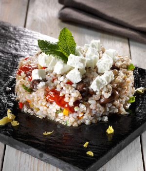 Buckwheat salad with vegetables, olives and feta
