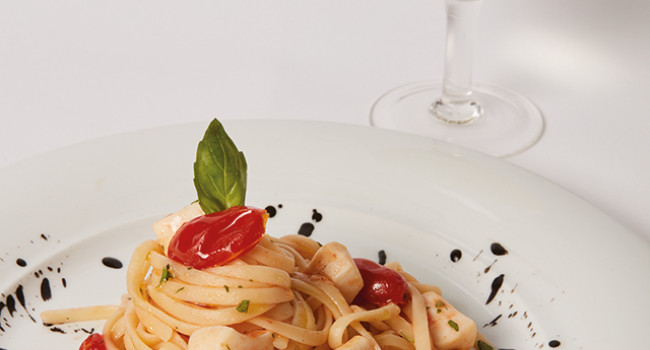 LINGUINE WITH CUTTLEFISH AND CHERRY TOMATOES ON A BED OF SQUID INK