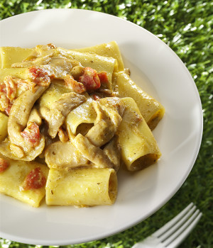 Paccheri pasta with porcini, pesto and tomato  concassé