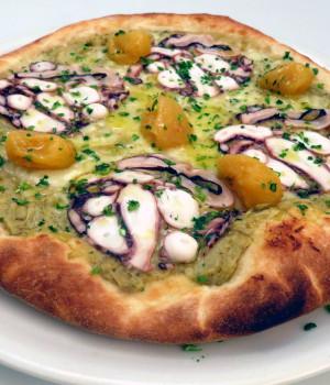 Pizza with Octupus carpaccio and artichokes