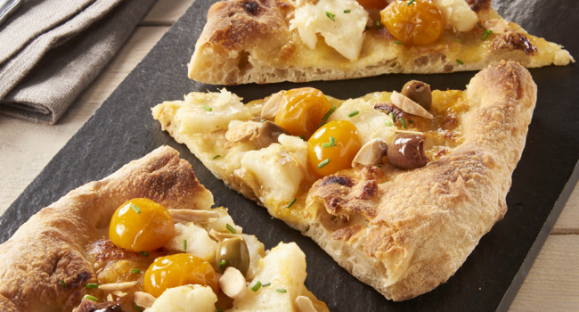 Pizza with salted codfish, yellow Datterini tomatoes and Taggiasca olives