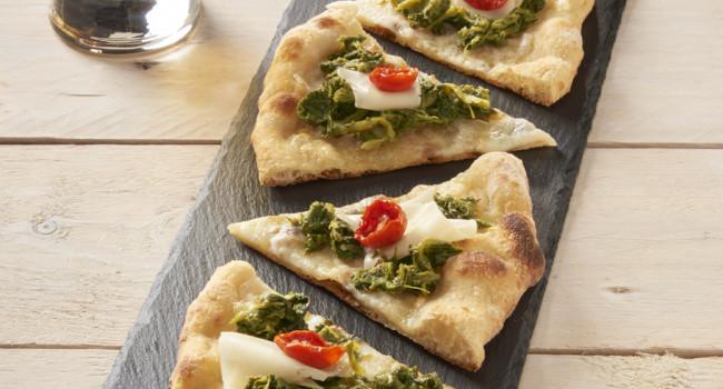 Pizza with turnip tops, Caciocavallo cheese and Dorati cherry tomatoes