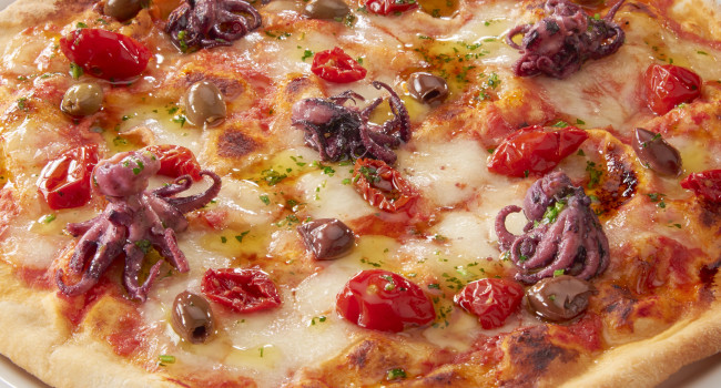 Pizza with baby octopus, leccino olives and dorati tomatoes