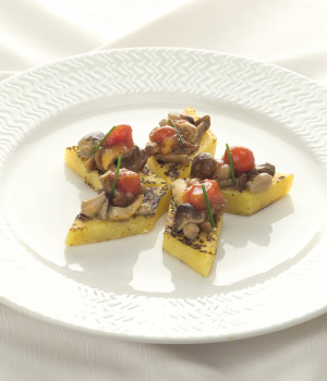 Grilled polenta with poker mushrooms and cherry tomatoes sauce