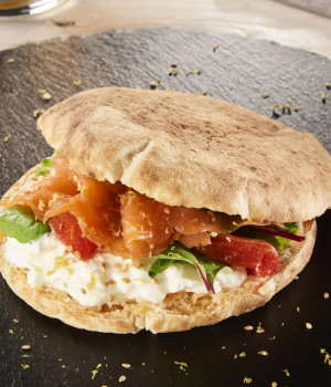 Puccia from Salento with smoked salmon, Stracciatella cheese and candied tomatoes
