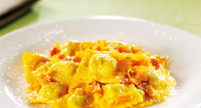 Ravioli with porcini mushrooms , pancetta and saffron sauce
