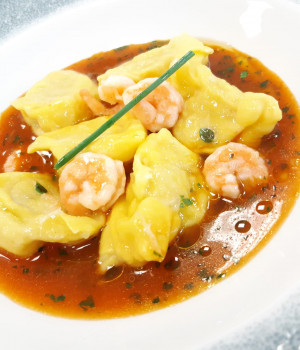 "Grouper Stuffed ""Plin"" Ravioli with prawns and bisque sauce"