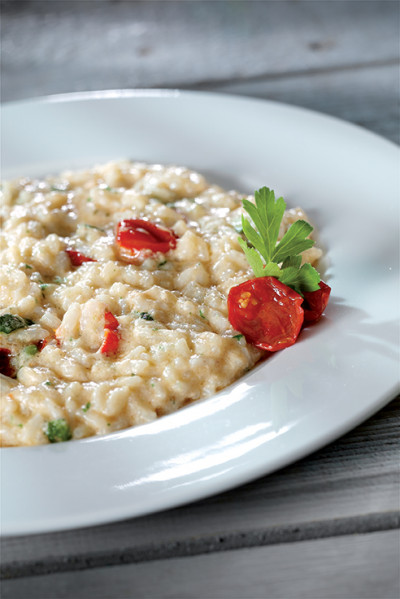 Risotto with zucchini, cherry tomatoes and scampi cream