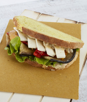 Vegan pumpkin bread sandwich with vegetables and tofu