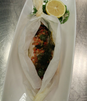 Sea bass fillet cartouche with vegetables and castelvetrano olives