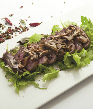 Beef tagliata with woodland infusion