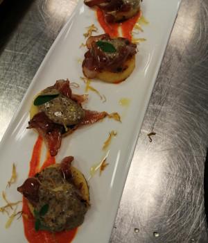 Polenta bites with black olive mayo  smoked goose and peperonata coulis