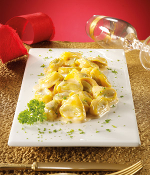 Tortelli stuffed with artichokes on smoked scamorza velloute