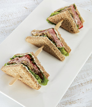 Trio of sandwiches with ham and sautéed field mushrooms