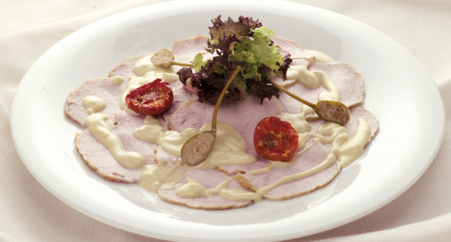 Veal with tuna sauce and caper berries