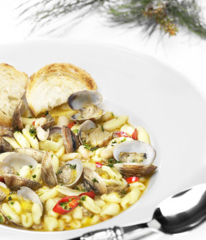 Cavatelli pasta soup with clams and cannellini beans